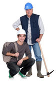 Experienced tradesman posing with his new apprentice — Stock Photo