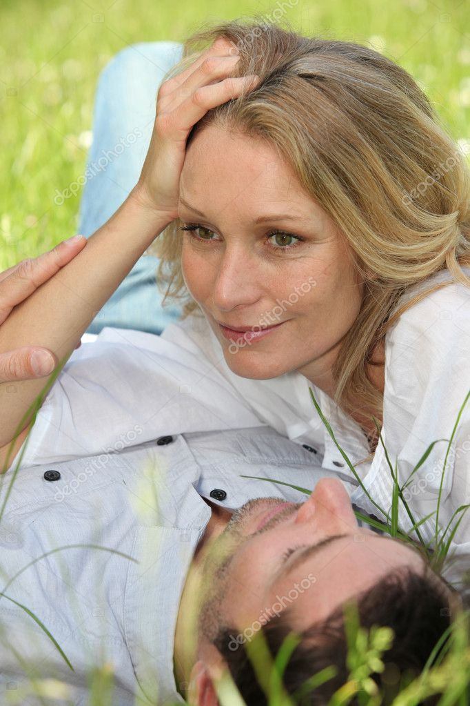 Couple lying on grass — Stock Photo #10154174