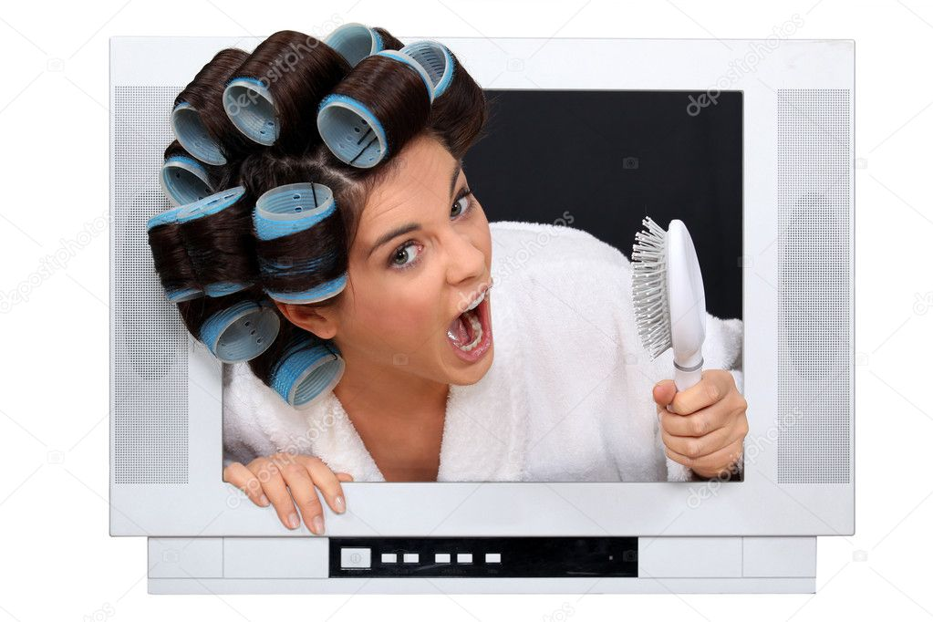 Woman in rollers inside a television  Stock Photo #10158507