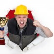 Proud builder holding trophy — Stock Photo