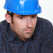 Royalty-Free Stock Photo: Portrait of tradesman lacking self-confidence
