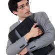 Stock Photo: Businessmholding tight his briefcase
