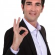 Portrait of smart man making okay sign — Stock Photo #10194983