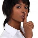 Woman making shush gesture — Stock Photo