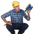 Stock Photo: Mholding electric sander