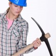 Woman with a pickaxe — Stock Photo #10196383