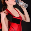 Female boxer drinking from water bottle — Stock Photo #10196986