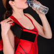 Female boxer drinking from water bottle — Stock Photo