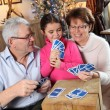 Family playing card game at Christmas — Stock Photo