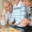 Family completing a puzzle together — Stock Photo
