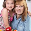 Mother and daughter in the kitchen — Stock Photo #10197762