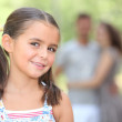 Little girl in the park with parents — Stock Photo
