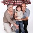 Stock Photo: Stay under umbrellhoney