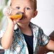 Boy with baby bottle — Stock Photo