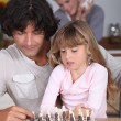 Father playing with daughter savory — Stock Photo