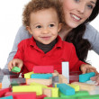 Mother sat with son playing building blocks — Stock Photo