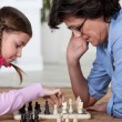 Mother and daughter playing chess — Stock Photo
