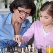 Mother and daughter playing chess — 图库照片