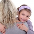 Young girl hugging her mother — Stock Photo #10198051