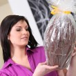 Woman with an enormous chocolate egg — Stock Photo #10198214