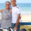 Mature couple embracing on promenade — Stock Photo