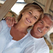 Couple on exotic holiday to tropical island - Stock Photo