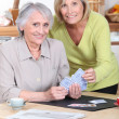 Older women playing cards — Stock Photo
