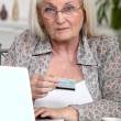 Stock Photo: Grandmother shopping online