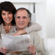 Mature couple looking at a newspaper — Stock Photo #10198558