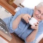 Senior woman enjoying a cup of tea — Stock Photo