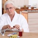 Elderly taking drugs — Stock Photo