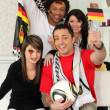 Group of friends supporting the German football team — Stock Photo