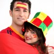 Couple supporting the Spanish football team - Stock Photo