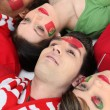 Stock Photo: Supporters of Portugal lying on the floor