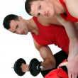 Muscular fellow lifting weight and guy with boxing gloves — Stock Photo #10198966