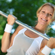 Woman lifting weights — Stock Photo