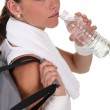 Woman drinking water after sport — Stock Photo #10199060
