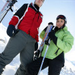Stock Photo: Teenagers skiing