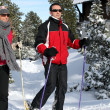 Stock Photo: Couple snow-shoeing
