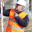Experienced construction site surveyor — Stock Photo