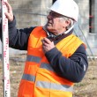 Stock Photo: Experienced construction site surveyor