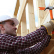 Housebuilder using a hammer — Stock Photo