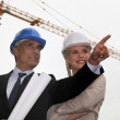 Stock Photo: Architect and assistant happy with progress