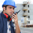 Stock Photo: Foremon construction site giving orders viradio