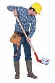 Mason shoveling money — Stock Photo