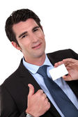 Man holding business card — Stock Photo