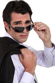 Cool businessman wearing sunglasses — Stock Photo