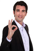 Portrait of smart man making okay sign — Stock Photo