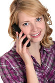 Attractive woman talking on the telephone — Stock Photo