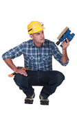 Man holding an electric sander — Stock Photo